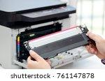 man replacing toner in laser...   Shutterstock . vector #761147878