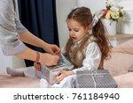 little girl sitting in a bed... | Shutterstock . vector #761184940