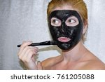 girl in a cosmetic black mask.... | Shutterstock . vector #761205088