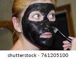 girl in a cosmetic black mask.... | Shutterstock . vector #761205100