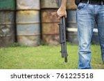 view of a man with a shotgun.   Shutterstock . vector #761225518