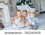 happy kids near xmas tree with...   Shutterstock . vector #761241910