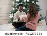 african american man gives a...   Shutterstock . vector #761273338