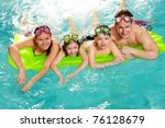 Cheerful Family In Swimming...