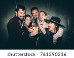group of happy friends drinking ... | Shutterstock . vector #761290216