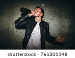 man drinking champagne from the ... | Shutterstock . vector #761301148
