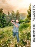 a professional photographer man ... | Shutterstock . vector #761308570