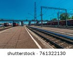 Small photo of the composition of train carriages loaded with goods worth at the station in the background of the train tracks. summer, bright sun and blue sky. rail waypoint arrow and semaphores.