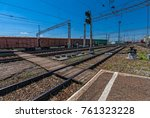 Small photo of the composition of train carriages loaded with goods worth at the station in the background of the train tracks. summer, bright sun and blue sky. rail waypoint arrow and semaphores