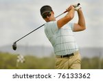 golfer swings his driver off... | Shutterstock . vector #76133362