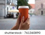 woman hands holding a paper cup ... | Shutterstock . vector #761360890