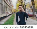 young man talking on his phone... | Shutterstock . vector #761386234