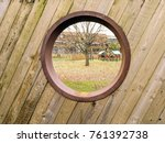 Wooden Fence With A Bog Round...