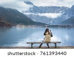 Woman Sitting On A Wooden Benc...