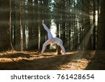 girl doing yoga in the dense... | Shutterstock . vector #761428654
