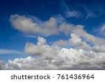 Small photo of Picturesque middle level stratocumulous , cumulous and altostratus with low stratus cloud formations on a hot sunny afternoon in summer are contrasted against the blue Australian sky.