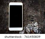 smart phone on old wood... | Shutterstock . vector #761450839
