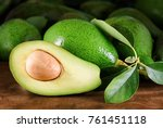 ripe green avocados with leaves ... | Shutterstock . vector #761451118