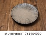 round plate on brown wooden... | Shutterstock . vector #761464030