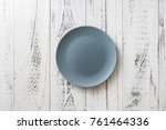 blue round plate on white... | Shutterstock . vector #761464336