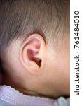 newborn baby ear  close up. | Shutterstock . vector #761484010
