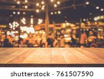 wood table top  bar  with blur... | Shutterstock . vector #761507590