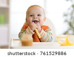 happy infant baby boy spoon... | Shutterstock . vector #761529886