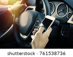 driver with mobile phone in the ... | Shutterstock . vector #761538736
