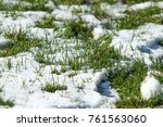 the first snow on the green... | Shutterstock . vector #761563060