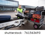 worker stacking luggage on... | Shutterstock . vector #761563693