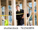 carpenter laughing while... | Shutterstock . vector #761563894