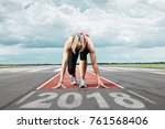 female runner waits for her... | Shutterstock . vector #761568406