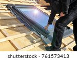 installing a skylight | Shutterstock . vector #761573413