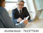 woman in banker's office... | Shutterstock . vector #761577634