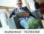 businessman in airport waiting... | Shutterstock . vector #761581468