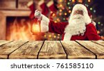 santa claus and wooden table... | Shutterstock . vector #761585110