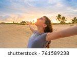 open arms girl at sunset... | Shutterstock . vector #761589238