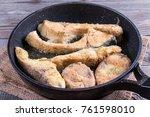 fried fish snacks on frying pan.... | Shutterstock . vector #761598010