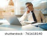 businessman working on laptop...   Shutterstock . vector #761618140