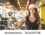 smiling fit woman in santa hat... | Shutterstock . vector #761624758