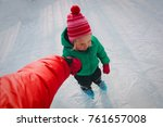 parent teaching child to skate... | Shutterstock . vector #761657008