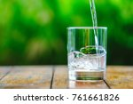 a glass of water on green...   Shutterstock . vector #761661826