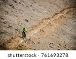 a cyclist practicing downhill...   Shutterstock . vector #761693278