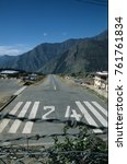 Small photo of A plane departs Runway 24 at Lukla airstrip in the Himalayas, Nepal