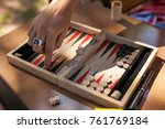 backgammon board. a hand on a... | Shutterstock . vector #761769184
