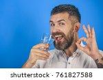 man with long beard hold water... | Shutterstock . vector #761827588