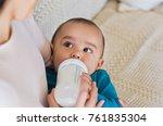 cute baby drinking milk from... | Shutterstock . vector #761835304