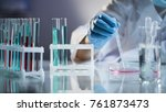 chemist intern mixing liquids ... | Shutterstock . vector #761873473