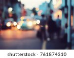 blurred people walking through... | Shutterstock . vector #761874310