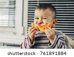 the little boy in the kitchen... | Shutterstock . vector #761891884